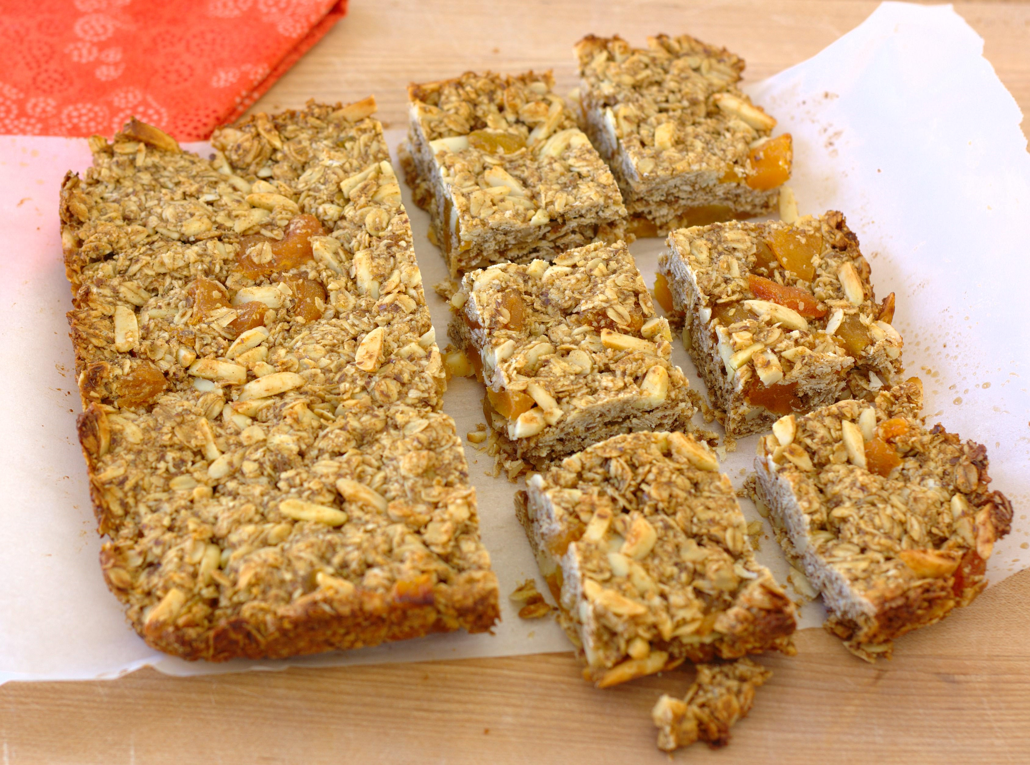 homemade granola bars out of the pan partially cut into squares