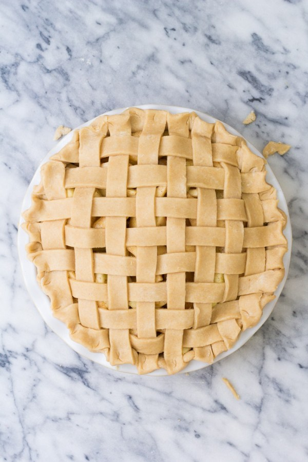 Pie with a woven lattice top crust and fluted edges.