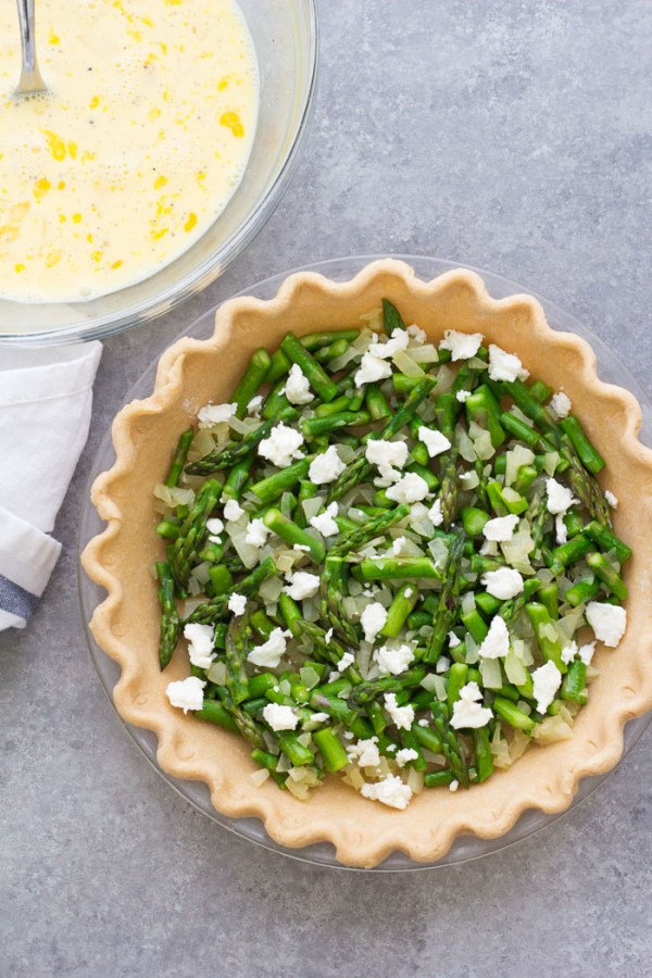 How to make asparagus quiche: whole wheat pie shell with asparagus, onion and goat cheese.