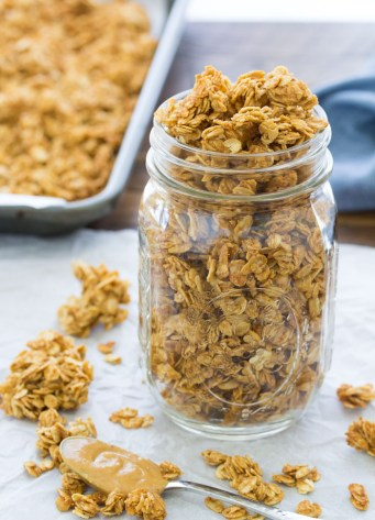This peanut butter granola is made with just 4 ingredients, in only 10 minutes of prep time. It's crisp and lightly sweetened with honey, with the perfect peanut butter flavor. Make it for a quick breakfast or snack!