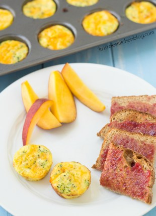 broccoli cheese frittatas on a plate with sliced peach and toast