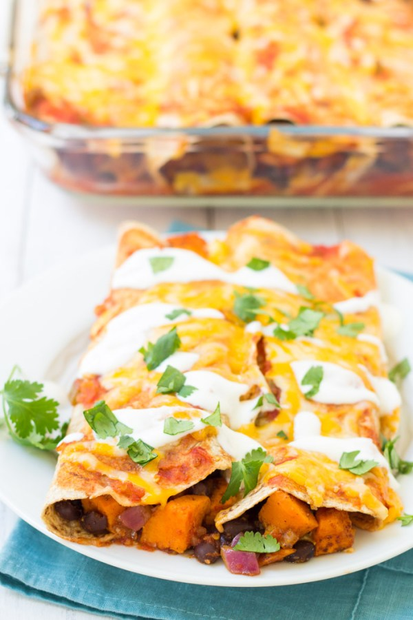 Vegetarian enchiladas with sweet potato and black beans on a plate.
