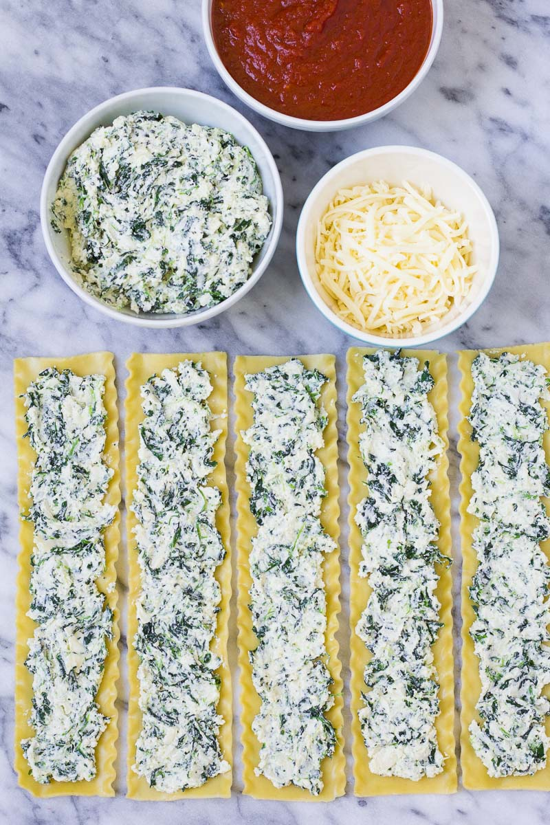 lasagna noodles with spinach and cheese filling spread on top