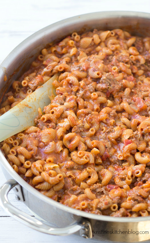 ingredients combined in the skillet simmering, ground beef, pasta, tomato sauce, seasonings