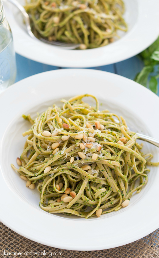 close up of pasta with kale pesto recipe mixed in and pine nuts