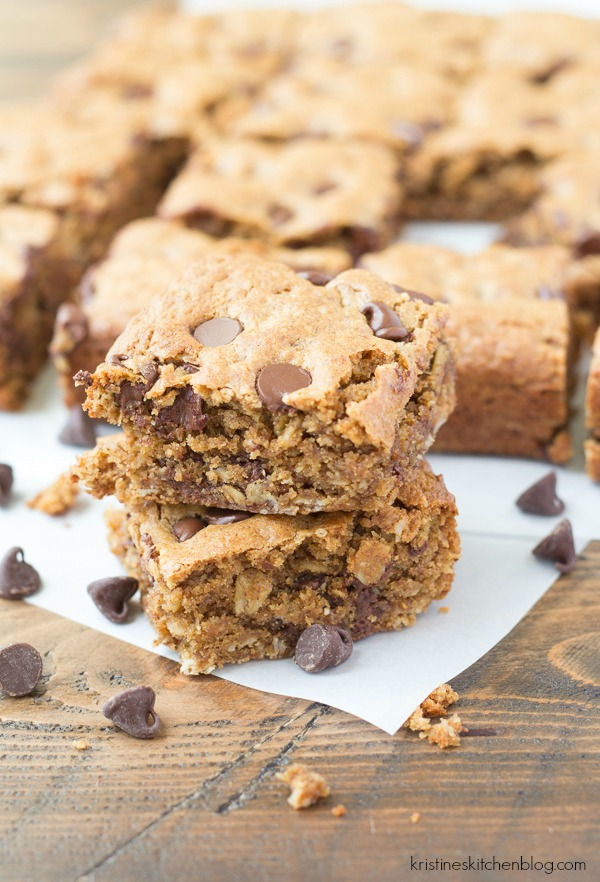 two blondies stacked with chocolate chips and more blondies in background