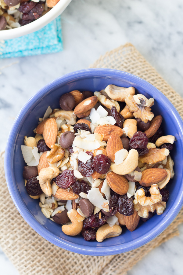 This Energy Boosting Trail Mix with Toasted Coconut and Dark Chocolate is a yummy and healthy snack! Packed with nuts, seeds, dried cherries and chocolate chips for the perfect balance of salty and sweet!