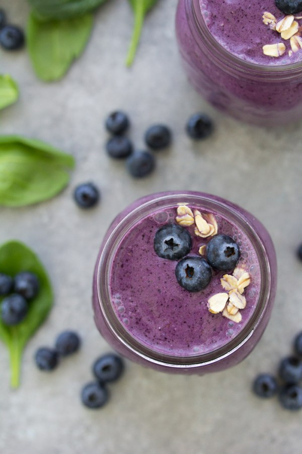 Start your day with this healthy smoothie and get in some greens, fruit, oats, and high protein yogurt! This Blueberry Spinach Breakfast Smoothie is packed with superfoods and perfect for busy mornings! It makes a healthy breakfast for kids or a nutritious snack. There is no banana in this blueberry smoothie.