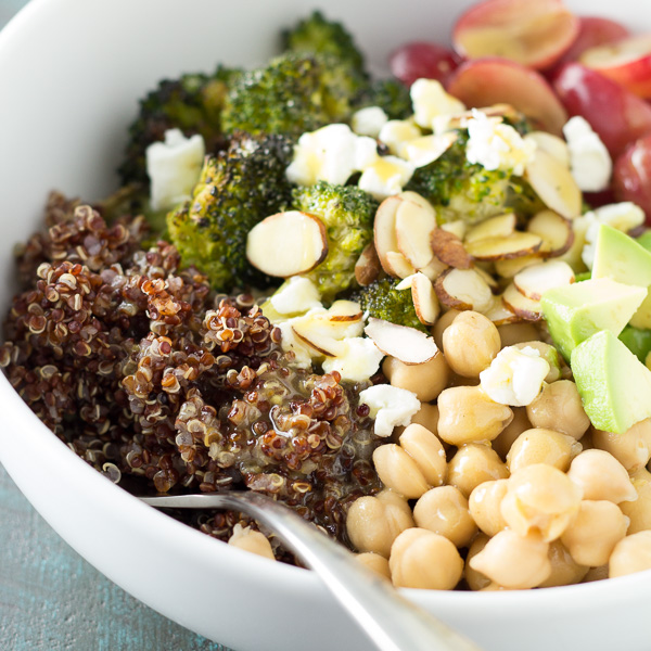 a salad of broccoli, quinoa, chickpeas, grapes almonds avocado