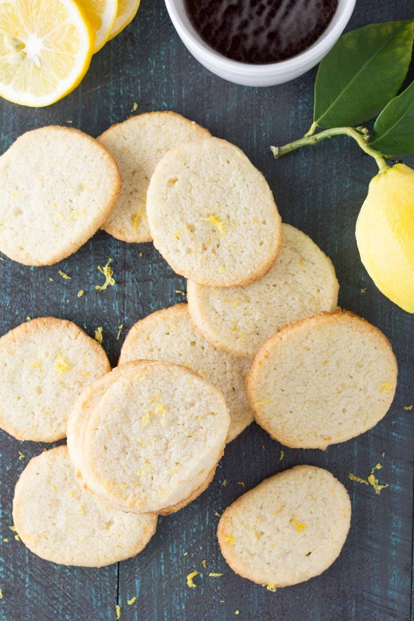 Crisp Lemon Almond Shortbread Cookies with a cup of tea.