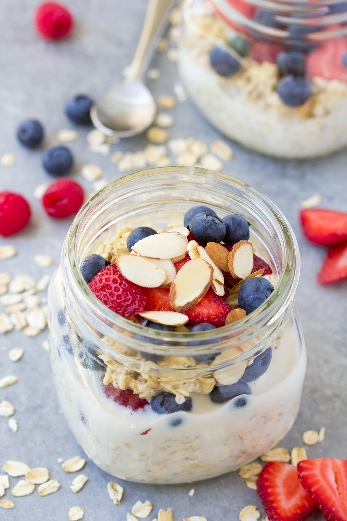 overnight oats in a jar with with fresh berries and almonds.