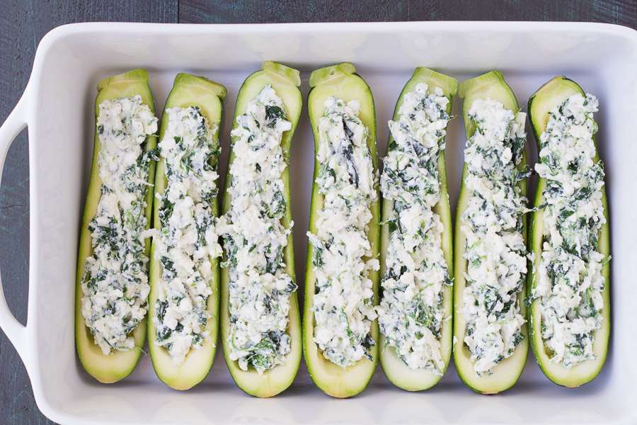 step of zucchini halves stuffed with cheese and spinach mixture