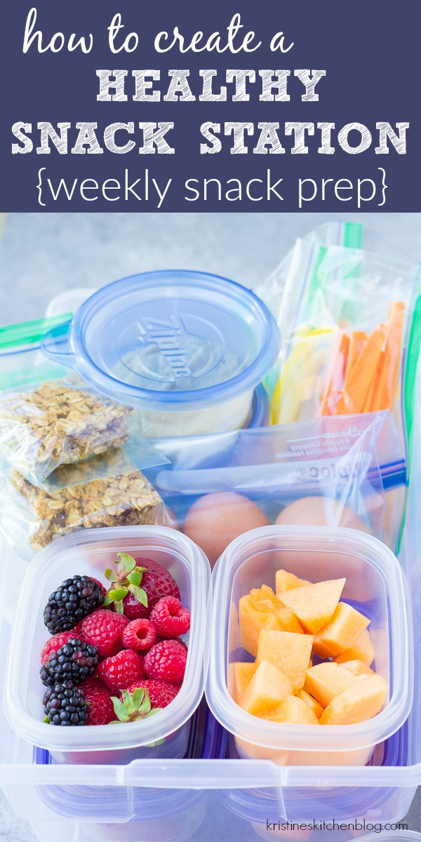 prepared healthy after school snacks for kids including fruits and vegetables, homemade granola bars, hummus etc...