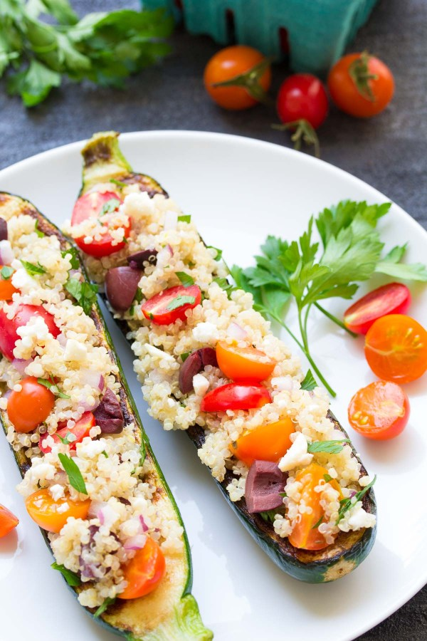 Greek Quinoa Grilled Zucchini Boats, with olives, tomatoes, and feta! These Mediterranean stuffed zucchini are easy, healthy, vegetarian, and gluten free! | www.kristineskitchenblog.com