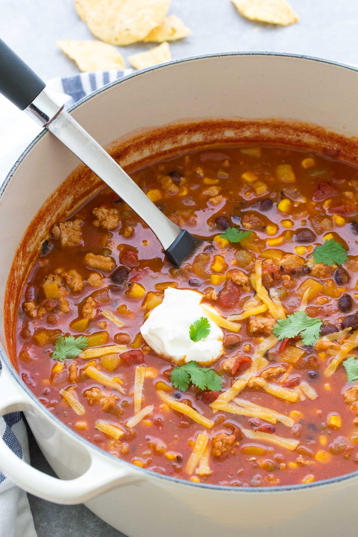 turkey taco soup in a dutch oven pot with a serving spoon