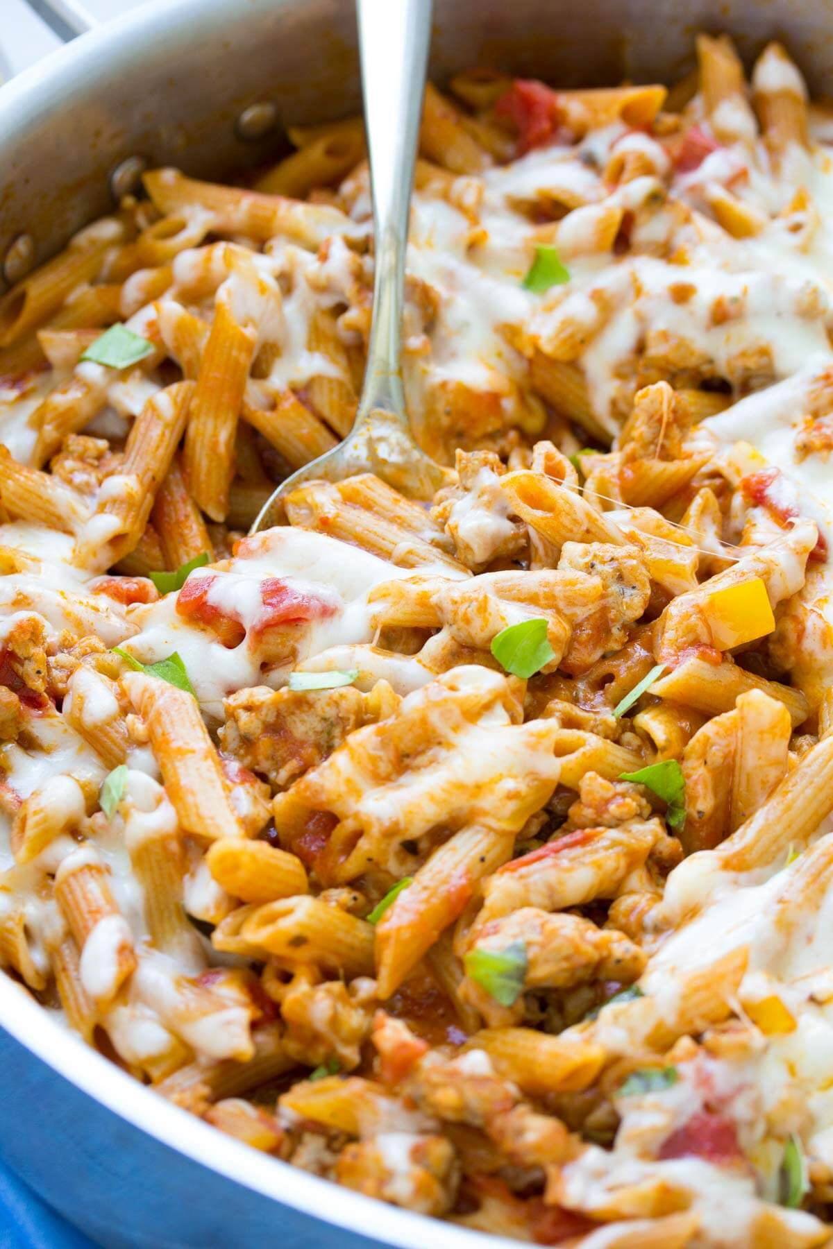 cheesy one pot pasta with sausage in a skillet