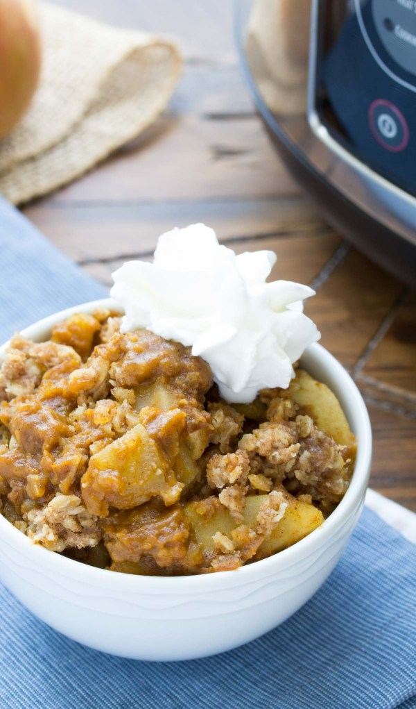 Slow Cooker Pumpkin Apple Crisp! An irresistible combination of pumpkin pie and apple crisp, made completely in your crock pot! | www.kristineskitchenblog.com