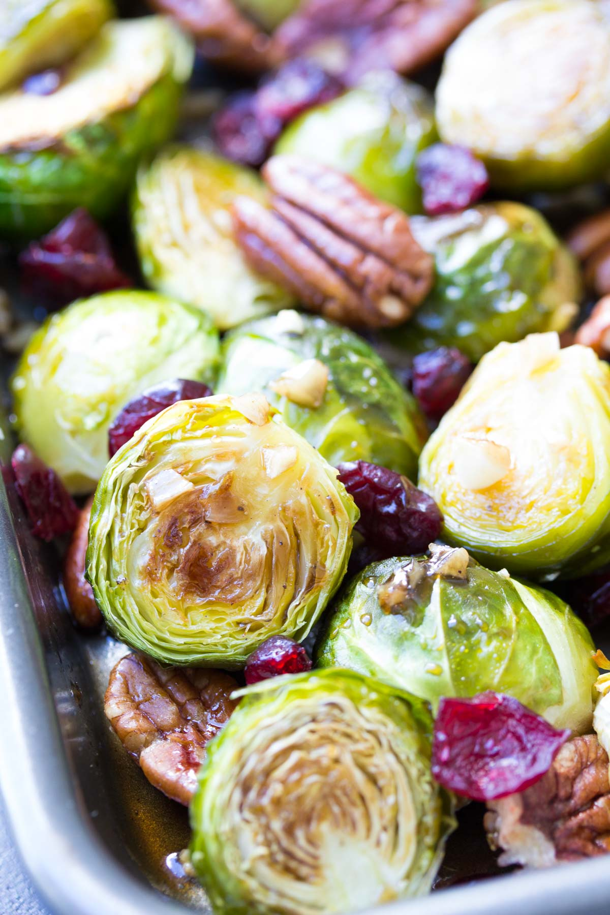 Close up of balsamic brussels sprouts with garlic, pecans and cranberries.
