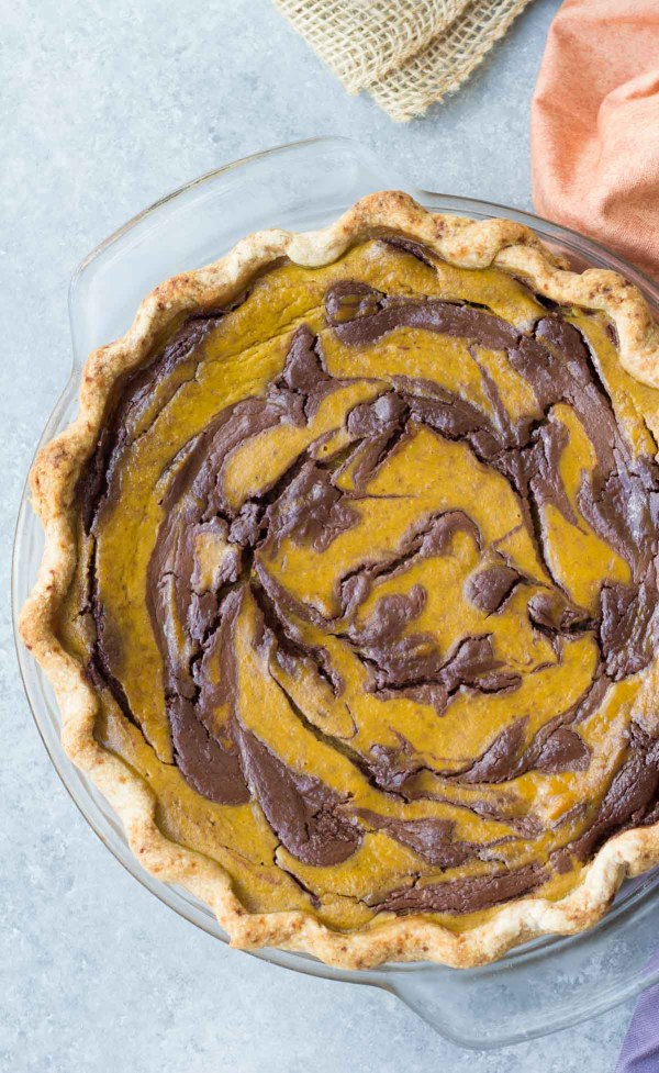 whole pumpkin pie with chocolate swirl ready to cut and serve