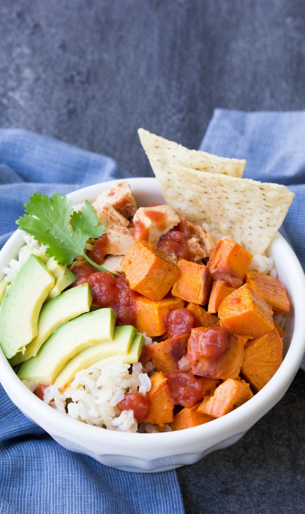 Easy Taco Chicken and Sweet Potato Burrito Bowls. Make these with leftover slow cooker taco chicken for a quick lunch or dinner!   www.kristineskitchenblog.com