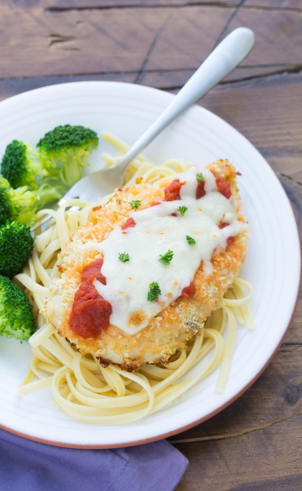 Lightened Up Baked Chicken Parmesan with linguine pasta and broccoli is an easy 30 minute meal!   www.kristineskitchenblog.com