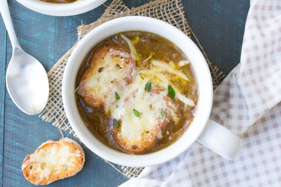 A simple French onion soup recipe, with just four easy steps! With caramelized onions, a rich and hearty broth, and toasted cheesy bread! | www.kristineskitchenblog.com