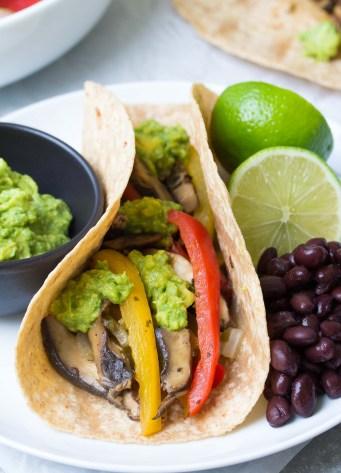 These Vegetarian Portobello Mushroom Fajitas are a 30 minute meal that you can prep ahead! With guacamole, these healthy vegan fajitas are hard to resist! | www.kristineskitchenblog.com