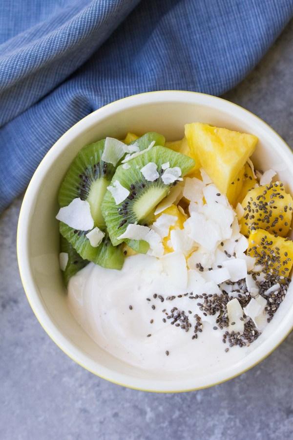 Dairy Free Tropical Yogurt Breakfast Bowl with pineapple, kiwi, coconut and chia seeds.