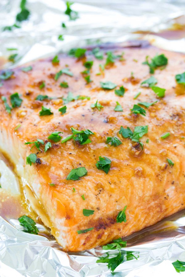Baked salmon filet with honey garlic glaze on a pan.