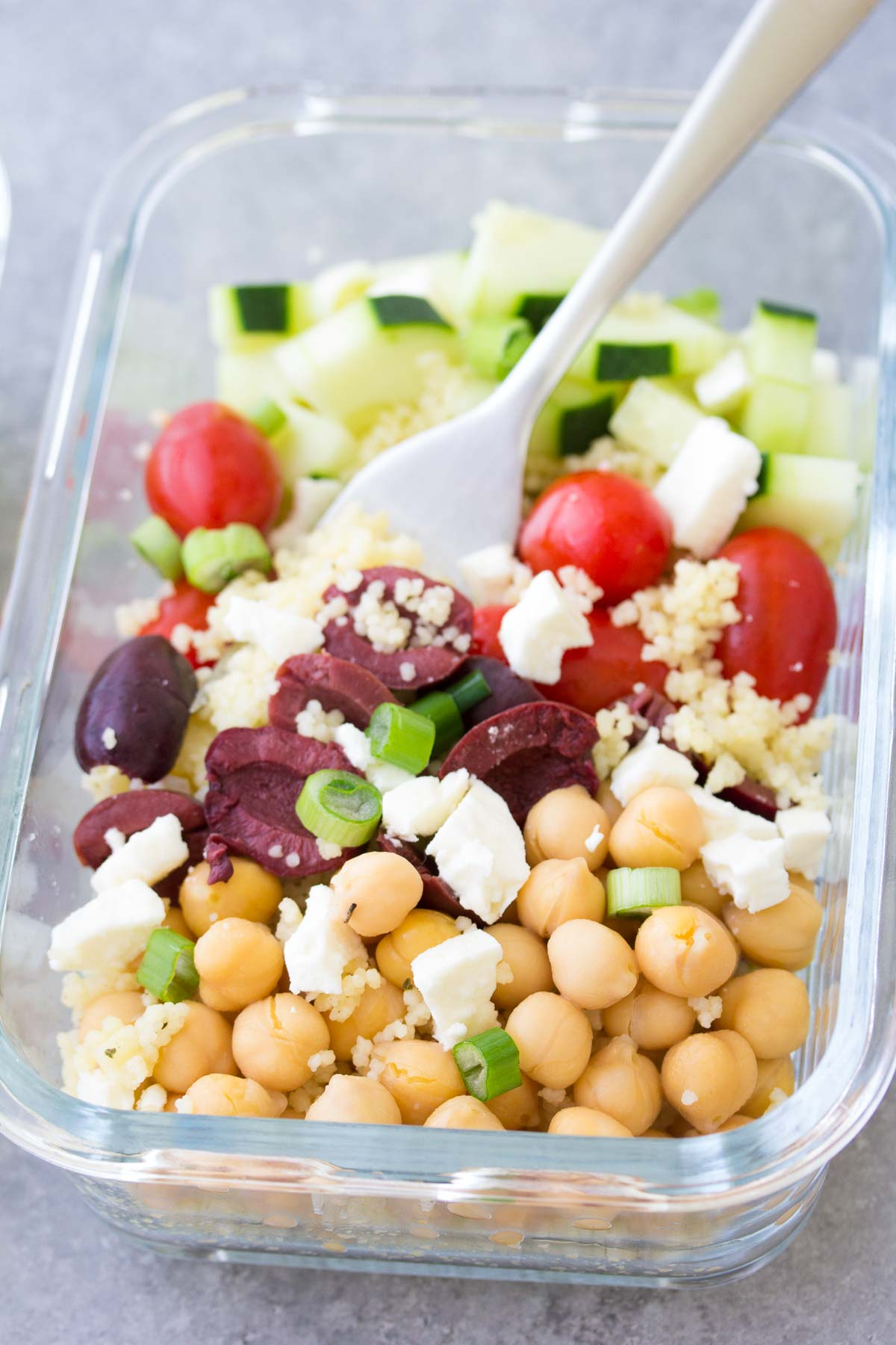 This Meal Prep Chickpea Salad is a healthy, vegetarian make ahead lunch. These lunch bowls are filled with healthy vegetables and chickpeas add protein! You can also serve this as a side salad at a BBQ.