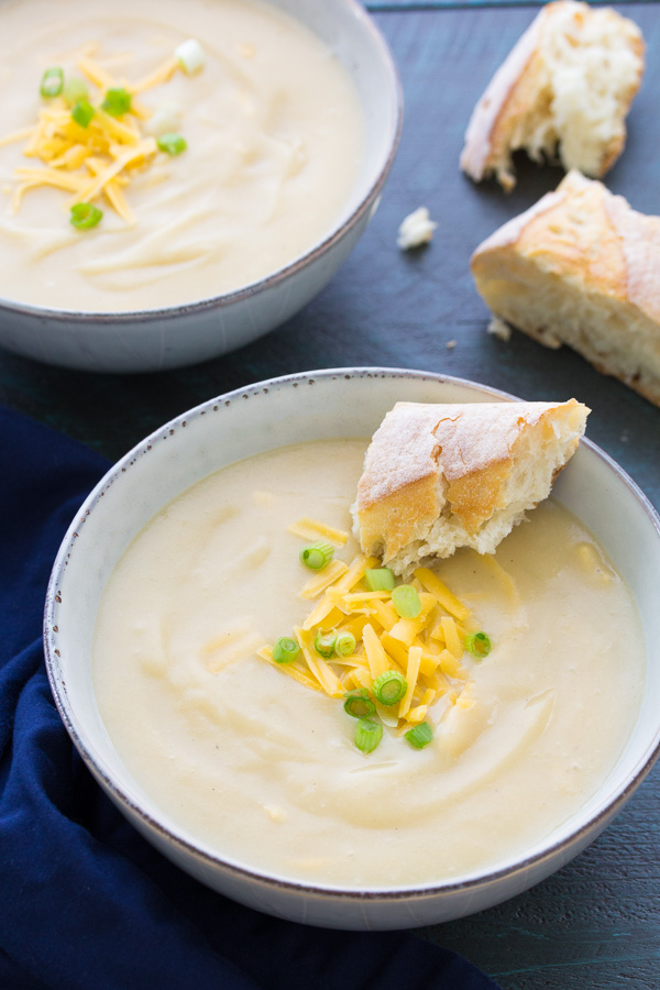 This Slow Cooker Potato Leek Soup with Cheddar is a comforting vegetarian meal. This soup is easy to make in your crock pot and the leftovers freeze well. This potato leek soup is incredibly smooth and creamy, yet it's made without cream. You can omit the cheese for a dairy-free version.