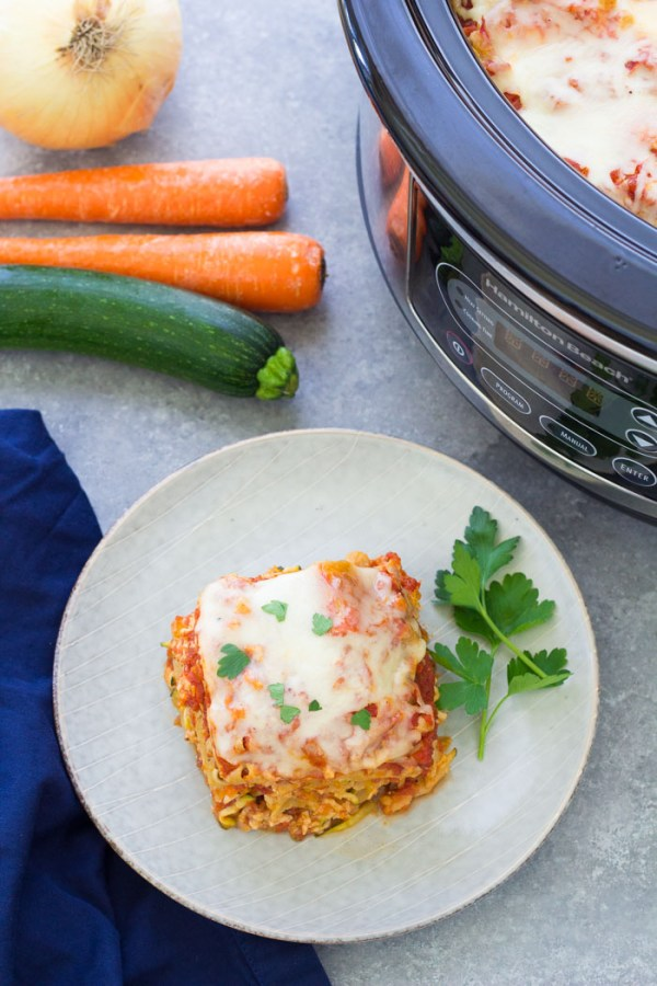Your family will love eating their vegetables with this Veggie-Packed Slow Cooker Lasagna! This healthier lasagna is made with ground turkey and veggies. The veggies are shredded and chopped small so this is a kid-friendly dinner. You can make this easy slow cooker lasagna vegetarian.