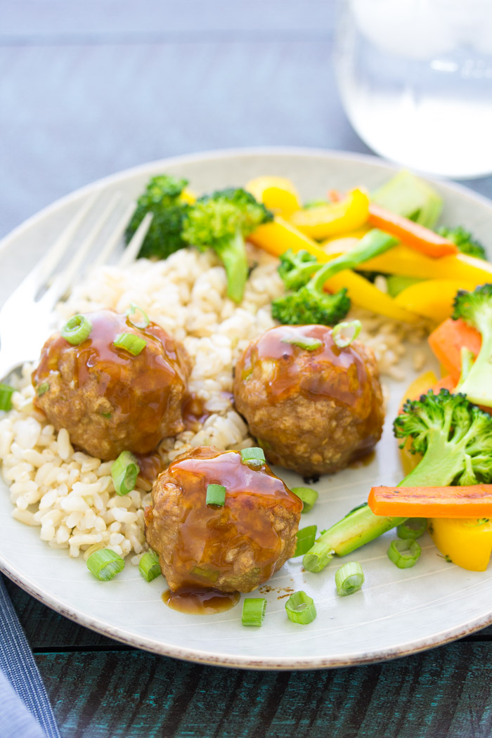 sweet and sour turkey meatballs served with rice and vegetables