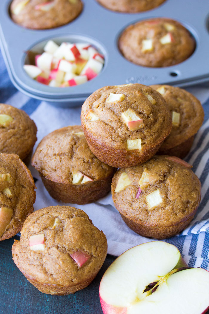 These healthy apples muffins are quick and easy to make in one bowl! This whole wheat muffins recipe is made with applesauce, fresh apples and cinnamon. Make a batch of these best apple muffins for your freezer this fall!