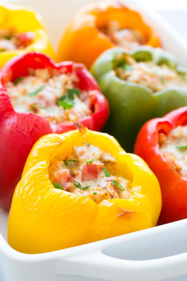 Stuffed bell peppers with rice, ground turkey or beef, tomato sauce and seasonings. These easy Italian stuffed peppers are a healthy meal that you can make ahead!