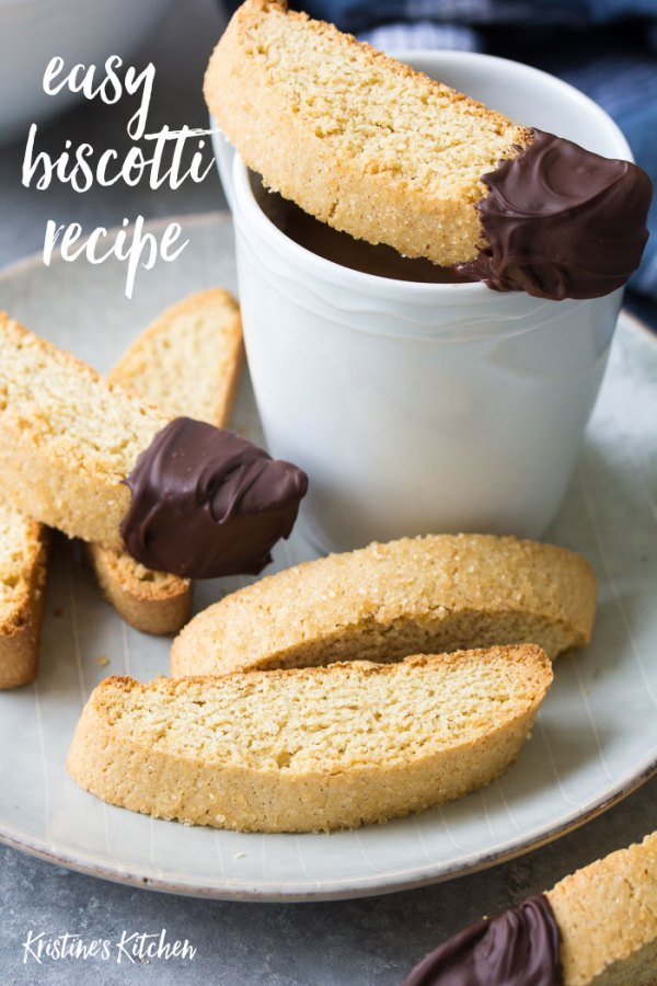 Classic vanilla biscotti cookies dipped in chocolate, on a plate with coffee.
