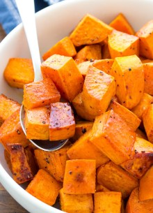 roasted sweet potatoes in a serving bowl with spoon