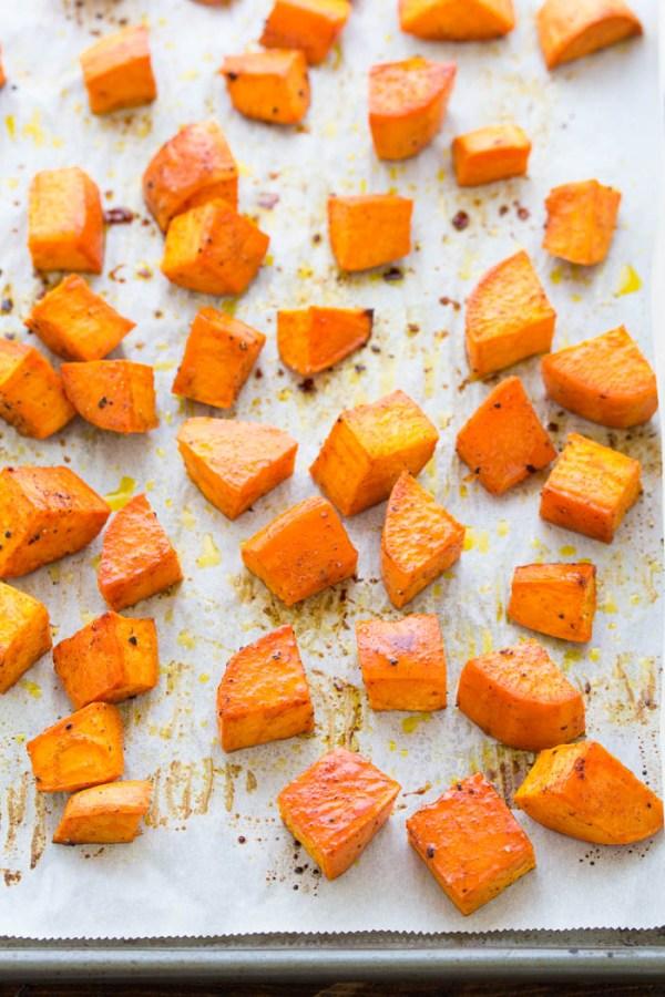 Honey roasted sweet potatoes on a pan.