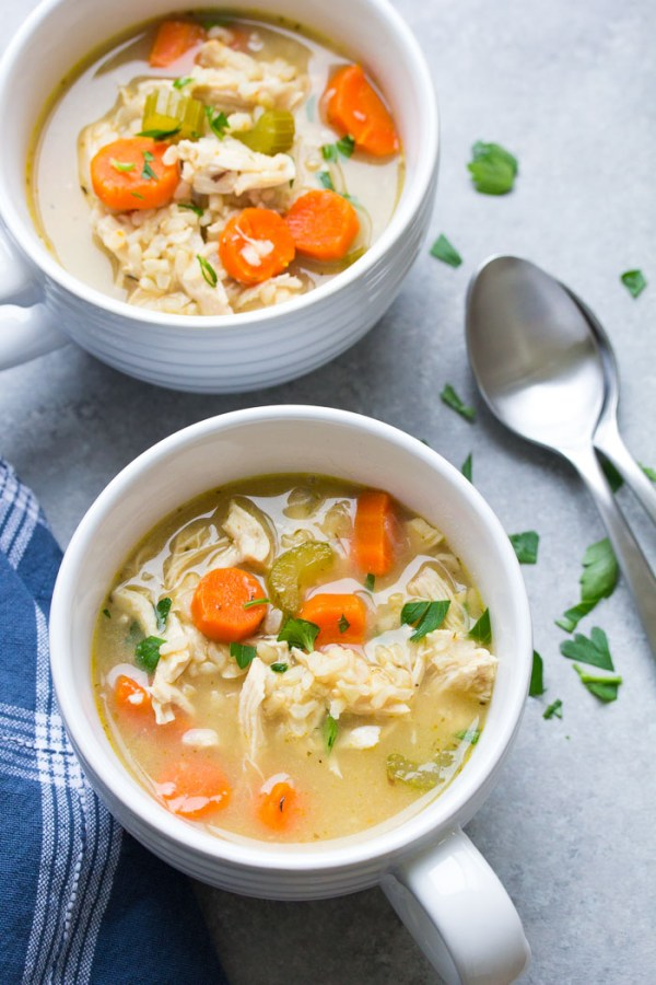 Two bowls of homemade chicken and rice soup.