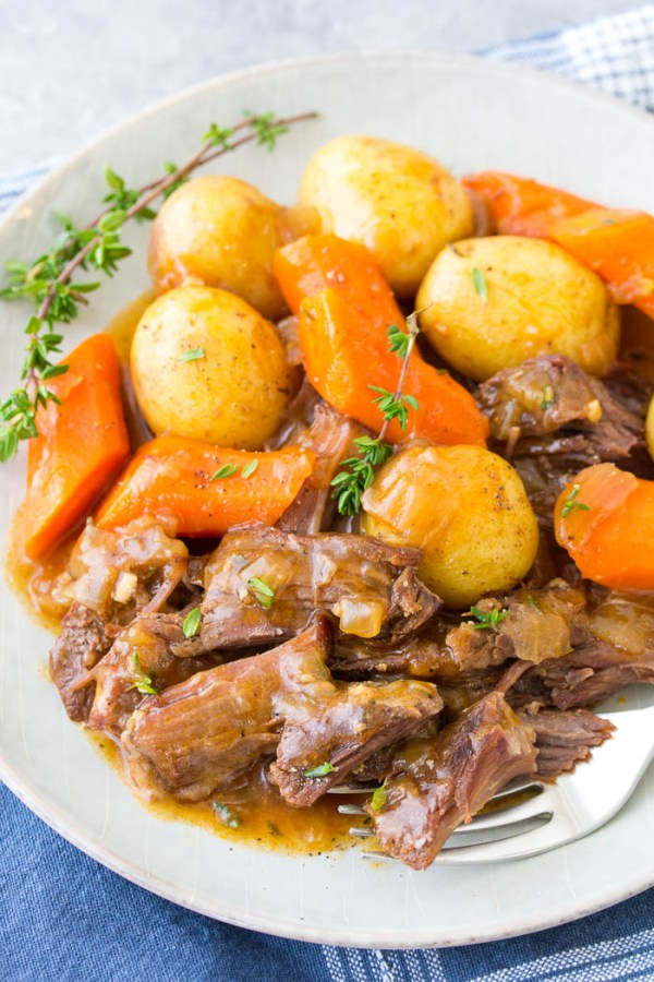 Instant Pot Pot Roast with potatoes, carrots and gravy. One of our favorite pressure cooker recipes!