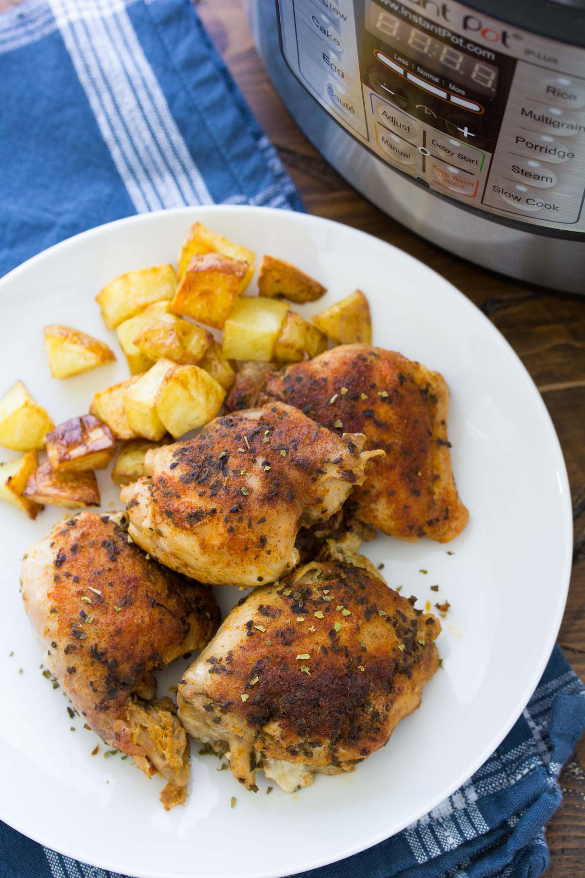 instant pot chicken thighs served with potatoes