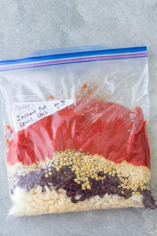 Freezer bag with ingredients for Instant Pot vegetarian lentil chili. Instant Pot/Crockpot Freezer Meal.