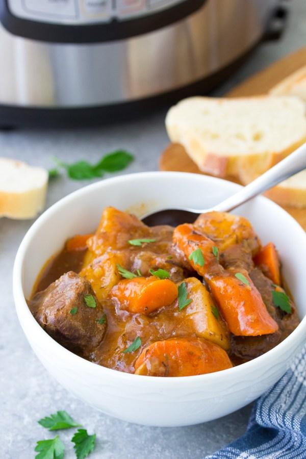 Rich and hearty Instant Pot beef stew recipe, served with crusty bread.