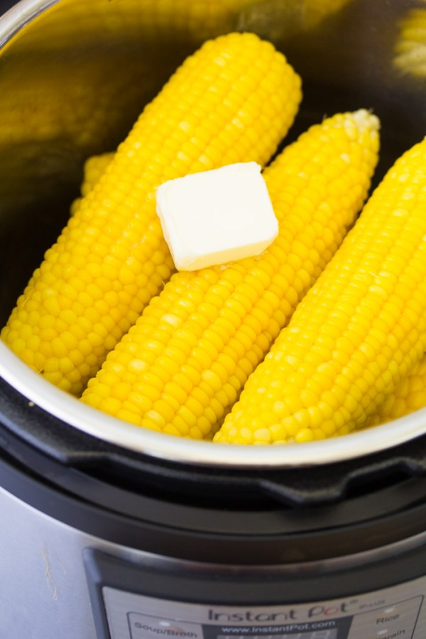 Cooked corn on the cob in an Instant Pot with butter.