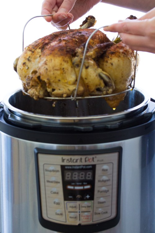 Using a trivet with handles to take a whole chicken out of an Instant Pot.