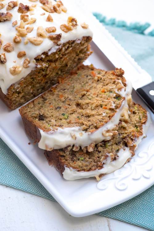 Carrot Zucchini Bread with cream cheese frosting and walnuts.