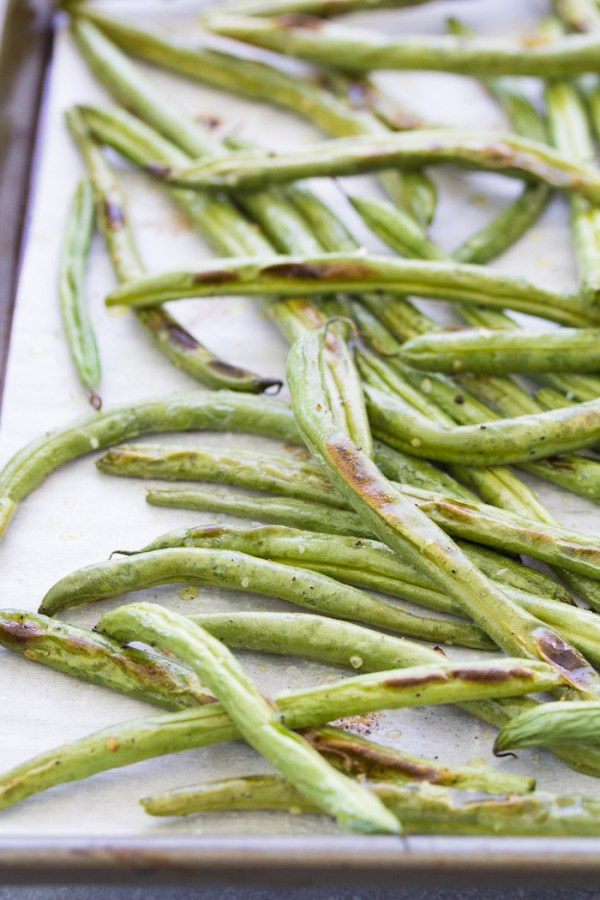 Close up view of roasted green beans after baking.