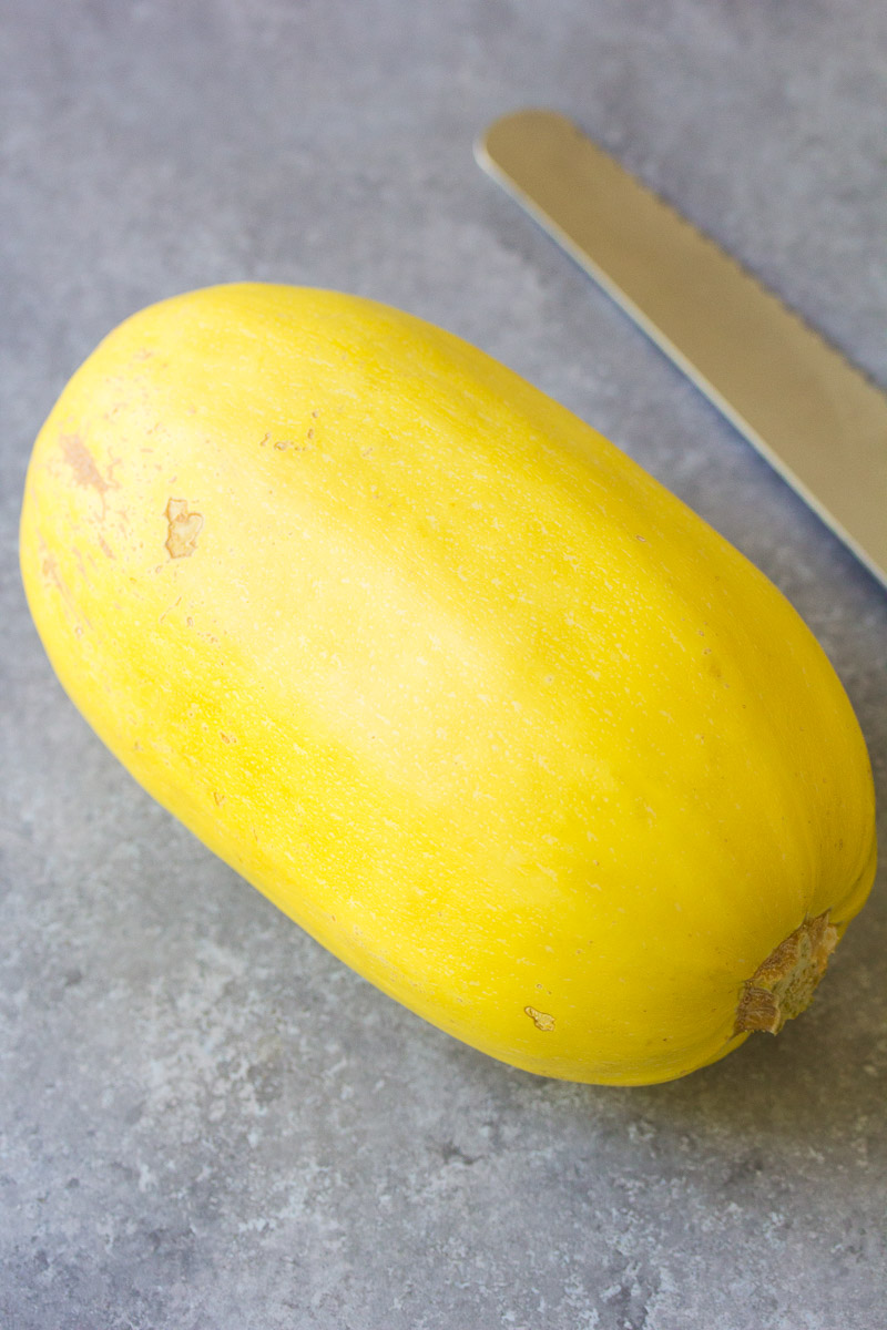 whole spaghetti squash and a knife