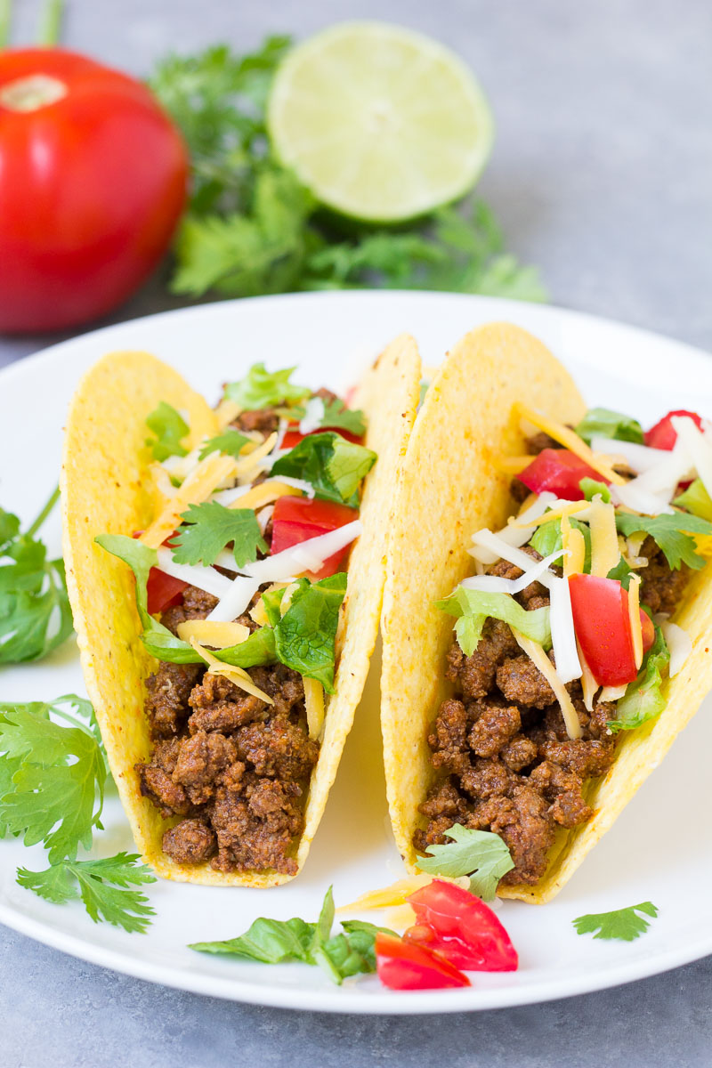 two beef tacos on a plate