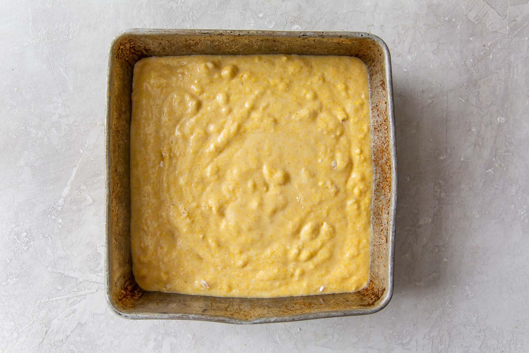 batter in square metal baking pan